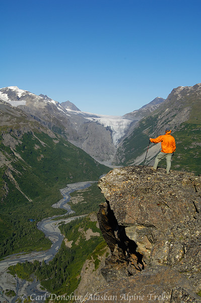 On the Bremner Mines to Tebay Lakes trip, this hiker takes in the view,  Wrangell - St. Elias National Park and Preserve, Alaska.
