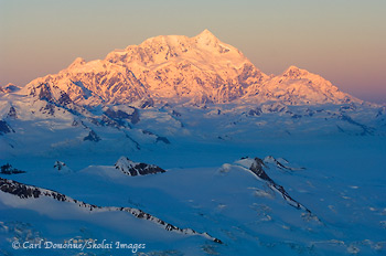 Mount Saint Elias, 18 008' high,catches the last of the sun's rays for the day, Wrangell - St. Elias National Park and Preserve, Alaska | aerial photo.